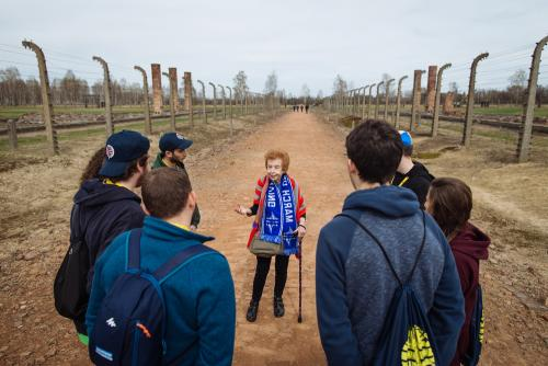 Eve Kugler with a group in Birkenau