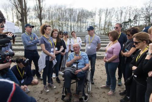 Ivor Pear shares his story by the Gas Chambers of Auschwitz, with his daughter and granddaughter in the group.